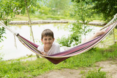 Boy in a hammock on the nature Stock Photo