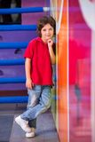 Boy With Hand On Chin Leaning On Wall Royalty Free Stock Images