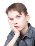 Boy with hand on chin Stock Photography