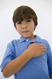 Boy With Hand On Heart Stock Image