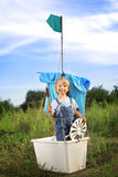 Boy in hand made ship outdoors play Royalty Free Stock Photography