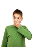Boy hand over mouth Stock Photo
