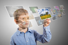 Boy hand reaching images streaming from the deep. Royalty Free Stock Image