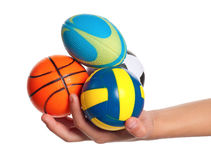Boy hand with small balls Stock Image