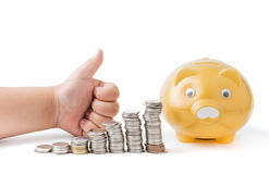 Boy hand with thumb up with money coin stack isolated Stock Photo