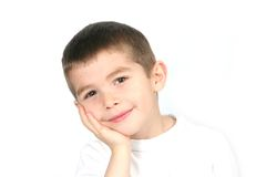 Boy with hand to face royalty free stock photography