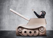 Boy in handmade cardboard panzer. Stock Image