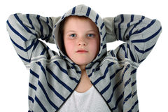 Boy with hands behind head isolated on white Stock Photo