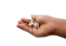 Boy hands with dice. Isolated in white Stock Images