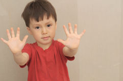 Boy with hands in front of himself Stock Photography