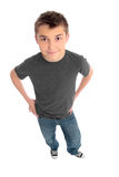 Boy hands on hips looking up at you Royalty Free Stock Photography