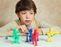 Boy hands making rock group musician from modeling clay Royalty Free Stock Image