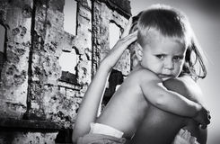 Boy on hands at mother escaping from accident Stock Photo
