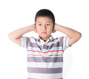 Boy hands off covering ears from loud noise, squeezing head with hands, having headache, Conflict resolution Stock Photos