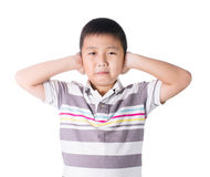 Boy hands off covering ears from loud noise, squeezing head with Stock Images