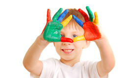Boy with hands in paint Royalty Free Stock Images
