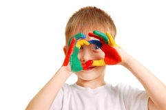 Boy with hands in paint Royalty Free Stock Photos
