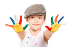 Boy with hands in paint on white Royalty Free Stock Photos