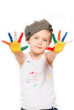 Boy with hands in paint on white Stock Photography