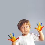 Boy with hands painted in colorful paints Royalty Free Stock Photo