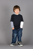 Boy with hands in pockets Stock Photos