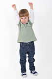 Boy with hands raised Stock Image
