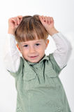 Boy with hands raised Stock Photo