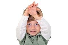 Boy with hands raised Stock Photography