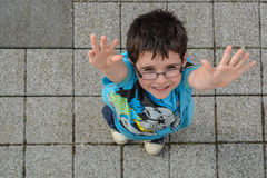 Boy with hands reaching up stock photos