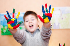 Boy with hands soiled in a paint Royalty Free Stock Images