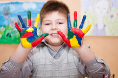 Boy with hands soiled in a paint Royalty Free Stock Image