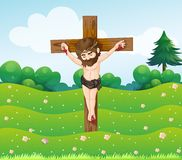 A boy hanging on the cross Stock Photography