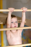 Boy hanging on the ladder. The boy climbs the stairs to the home sports complex Stock Photography