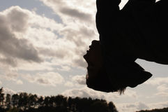 Boy hanging of upside down Stock Photo