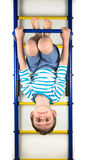 Boy hanging upside down. On a white background Royalty Free Stock Photos