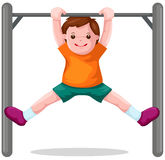 Boy hangs on  a horizontal bar Stock Photography