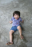 Boy happily making funny face. Boy sitting on the floor happily making funny face royalty free stock photos