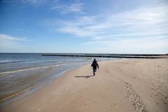 A boy happily runs on the beach Stock Photography