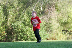 Boy happily runs at park Royalty Free Stock Photo