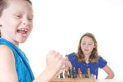 Boy happy about chess game Stock Images