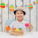 Boy is happy with Easter eggs Stock Photo