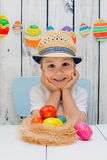Boy is happy with Easter eggs Royalty Free Stock Photography