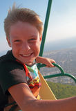 Boy with happy face on ferris wheel. Gelendghik stock images