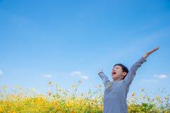 Boy happy in flower field Royalty Free Stock Photo