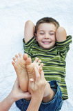 Boy happy funny tickling feet Royalty Free Stock Image