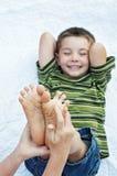 Boy happy funny tickling feet Royalty Free Stock Image