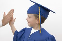 Boy / happy graduate. Boy and fathers hand. Focus on the face Royalty Free Stock Photo