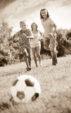 Boy with happy parents playing in soccer Royalty Free Stock Images