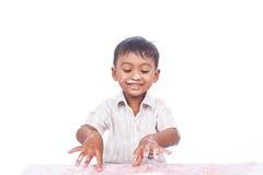 Boy happy play cream cake Stock Images