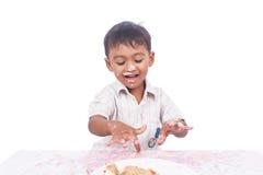 Boy happy play cream cake Stock Photography
